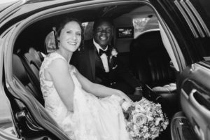 newlyweds get out of limousine