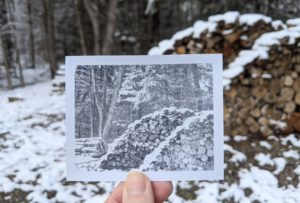 snow falling on stacked wood in vermont